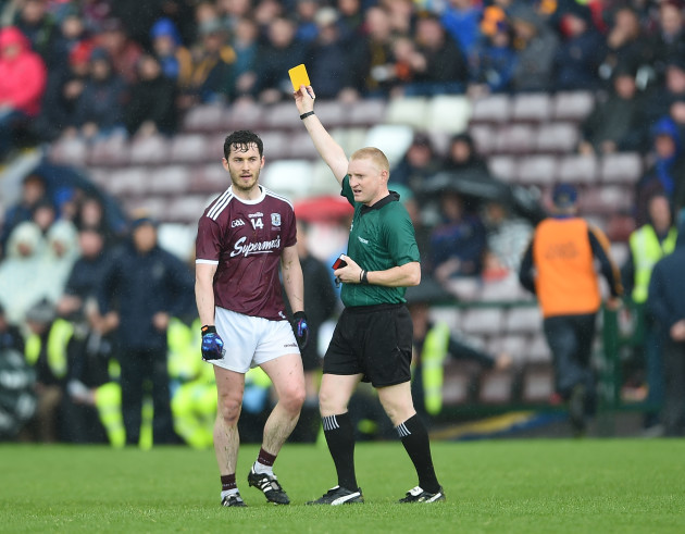 Ian Burke is shown a yellow card