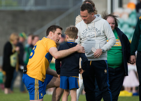 Gary Brennan gets a pic with a young supporter at the full time whistle