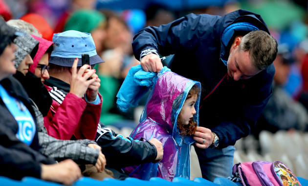 A young Dublin fan has her raincoat adjusted