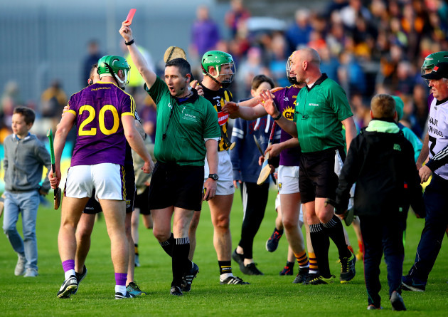 Aidan Nolan is red carded by ergal Horgan after the final whistle