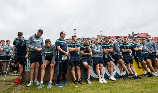 Members of the Limerick team watch the minor game