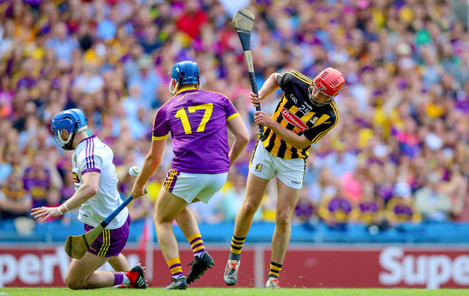 James Maher has a shot saved by Mark Fanning