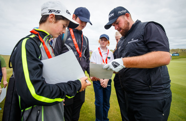 Shane Lowry signs autographs on the 3rd green