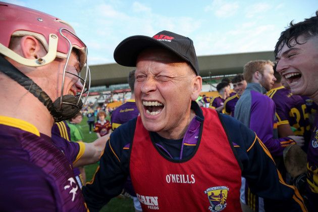 MT Reck celebrates after the game with Ross Banville and Niall Murphy