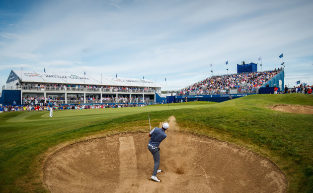 Padraig Harrington hits out of the bunker on the 18th hole in front of the Grand Stand