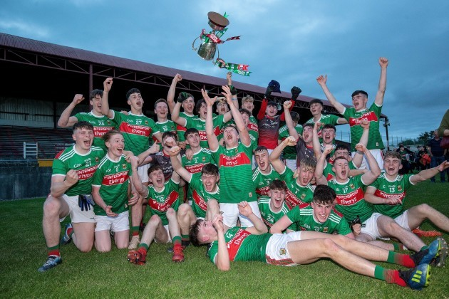 Mayo players celebrate with the trophy