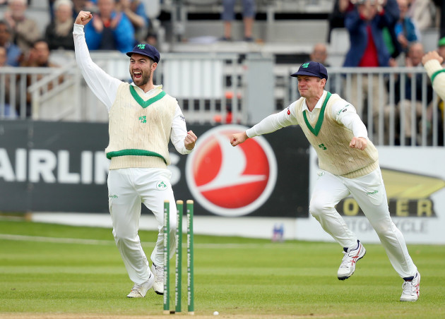 Andrew Balbirnie and William Porterfield celebrate the dismissal of Asad Shafiq bowled by Tim Murtagh