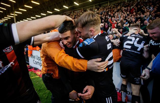Daniel Mandroiu celebrates scoring with Luke Wade-Slater
