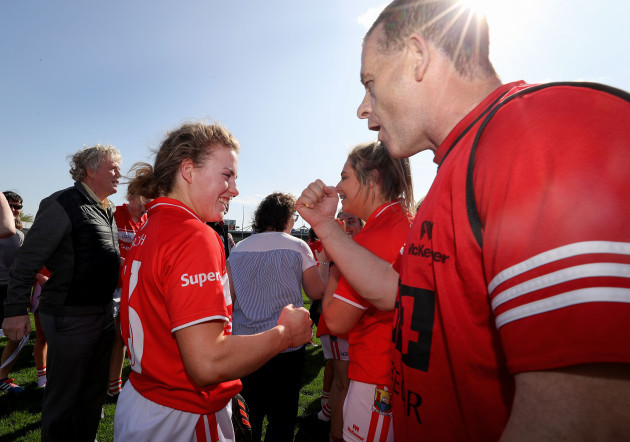 Libbby Coppinger and Ephie Fitzgerald celebrate after the game