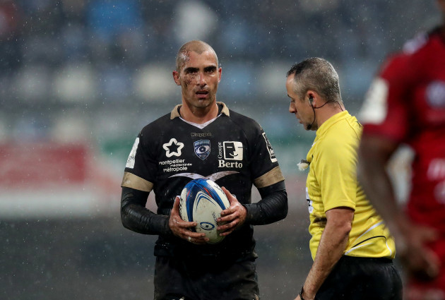 Montpellier's Ruan Pienaar with referee John Lacey