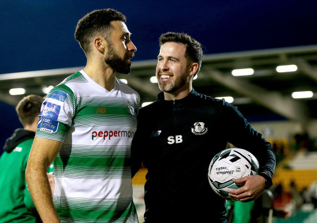 Stephen Bradley celebrates after the game with Roberto Lopes