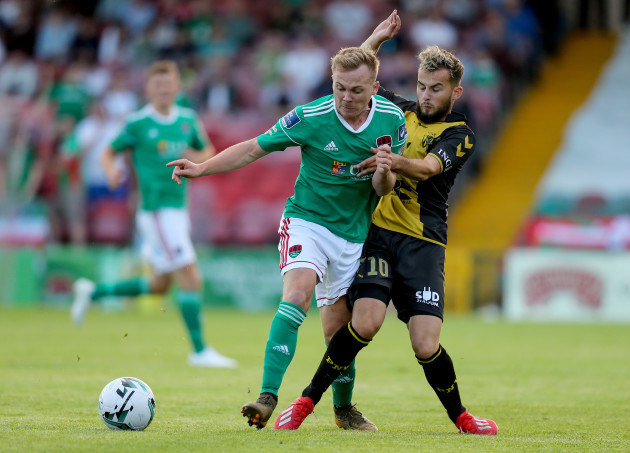 Conor McCormack is tackled by Belmin Muratovic