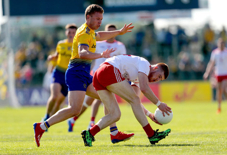 Niall Daly tackles Cathal McShane