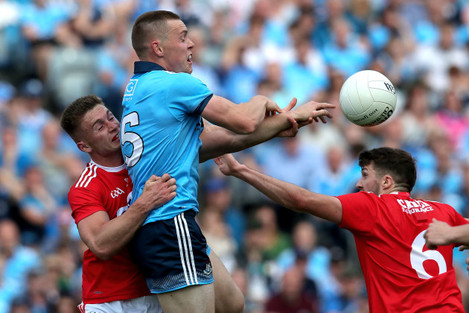 Kevin Flahive and Tomas Clancy tackles Con O'Callaghan