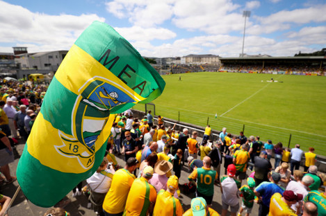 A Meath flag is raised in the crowd
