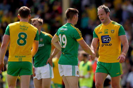 Michael Murphy shakes hands with Darragh Campion after the game