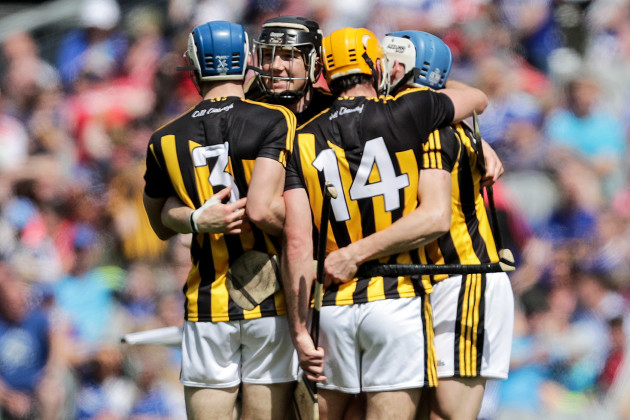 Huw Lawlor and Colin Fennelly celebrate at the final whistle with teammates