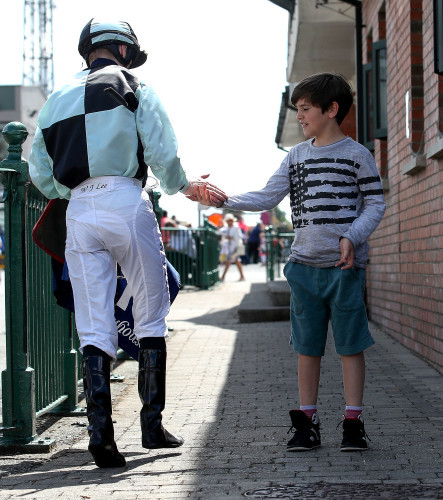 Jockey James Lee high fives a young fan after winning the Irish Stallion Farms EBF Maiden