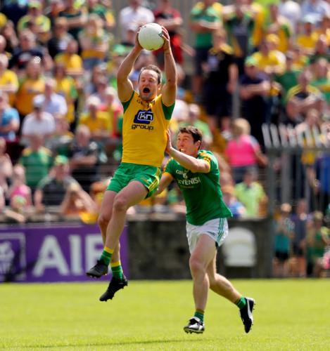 Padraic Harnan tackles Michael Murphy