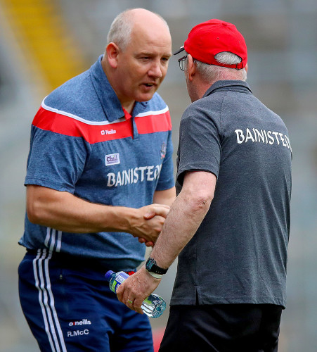 Ronan McCarthy with Mickey Harte at the full time whistle