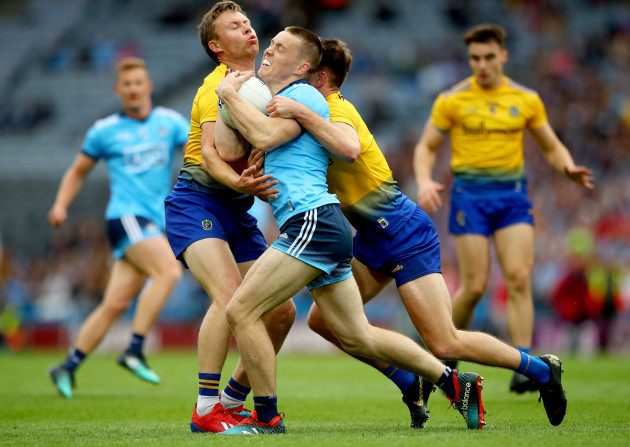 Niall Daly and Sean Mulloory tackle Con O'Callaghan