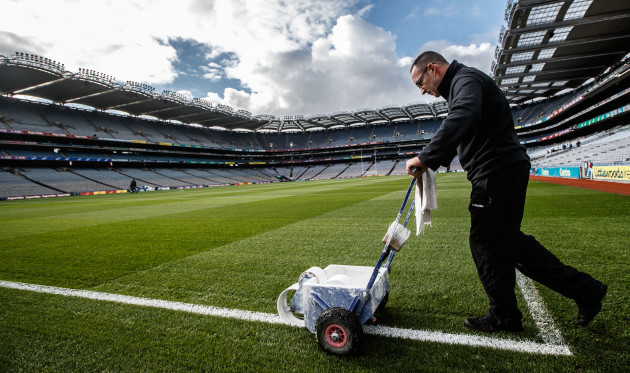 Enda Colfer paints the lines before the game