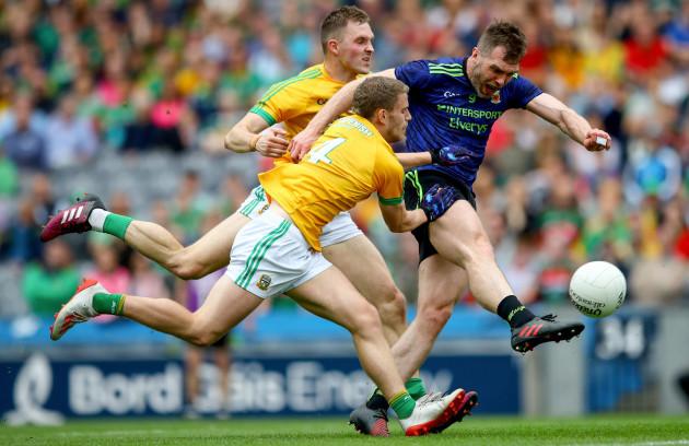 Conor McGill and Shane Gallagher tackle Seamus O'Seamus