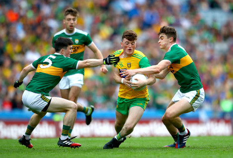 Paul Murphy and Sean O'Shea tackle Niall O'Donnell