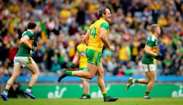 Michael Murphy celebrates scoring a penalty