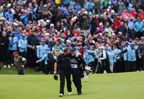 Shane Lowry celebrates winning with Brian Martin
