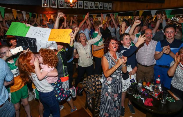 Fans celebrate Shane Lowry winning The Open