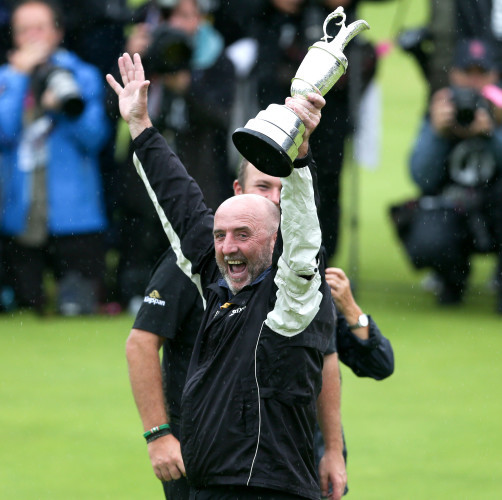 Shane Lowry's father Brendan celebrates with the Claret Jug