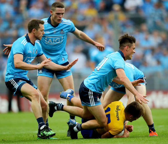 Dean Rock, Brian Fenton, Eric Lowndes and Paddy Small tackle Enda Smith