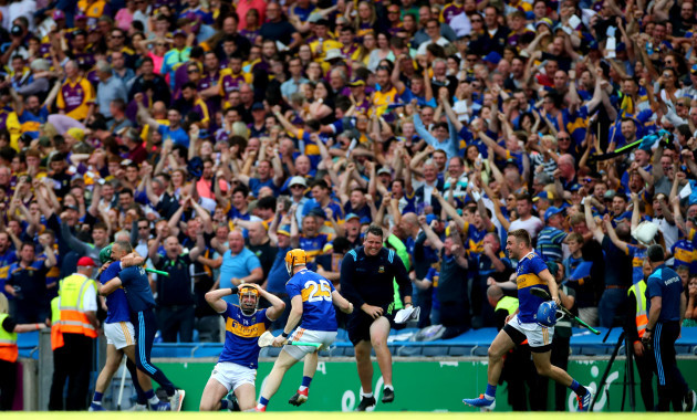 Seamus Callanan and Jake Morris celebrate at the final whistle