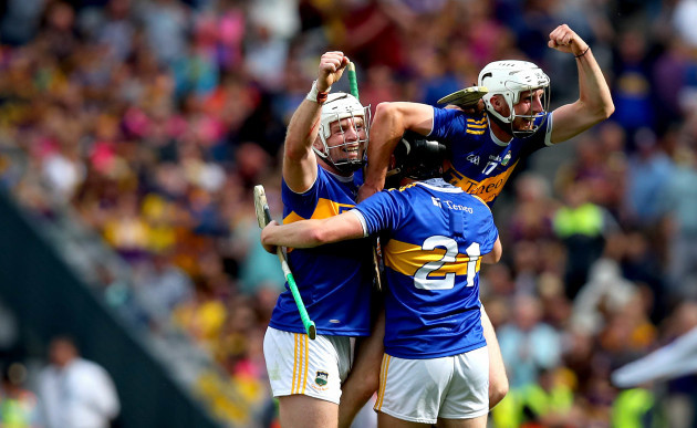 Padraic Maher, Alan Flynn and Ger Browne celebrate at the final whistle