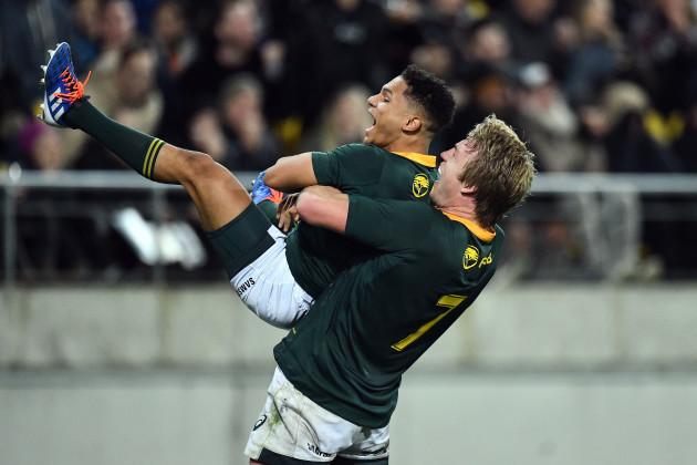 Herschel Jantjies celebrates scoring a try