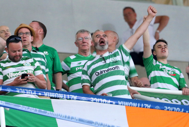 A Shamrock Rovers fan cheers on the team