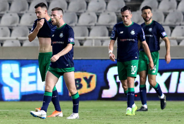 Aaron Greene, Jack Byrne and Aaron McEneff dejected after Apollon scored their second goal