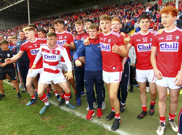 Cork players and substitutes wait for the final whistle during the dying seconds of the game