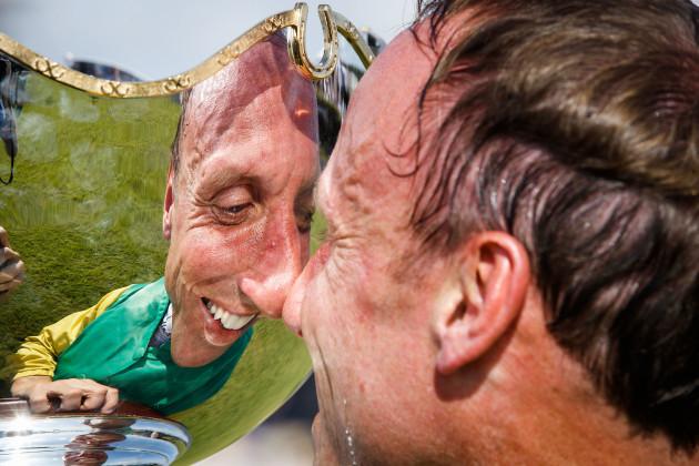 Robbie Power celebrates winning with the trophy