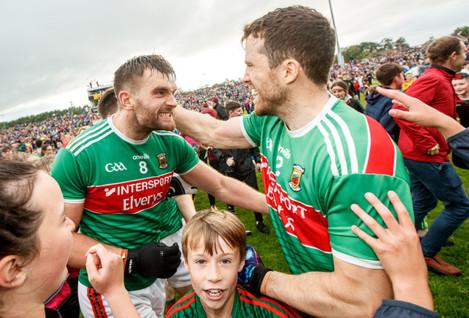 Aidan O'Shea and Chris Barrett celebrate after the game