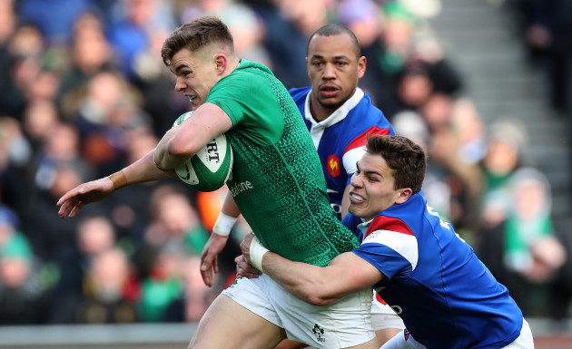 Ireland's Garry Ringrose is tackled by France's Gaël Fickou and Antoine Dupont