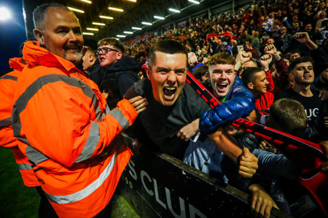 A Bohs' fan celebrates his side's third goal