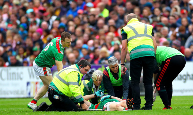 Jason Doherty leaves the field injured