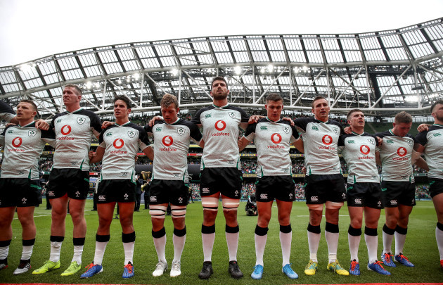 The Ireland team stand for the national anthems