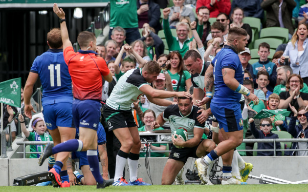 Dave Kearney celebrates scoring a try with Jordan Larmour and Tommy O'Donnell