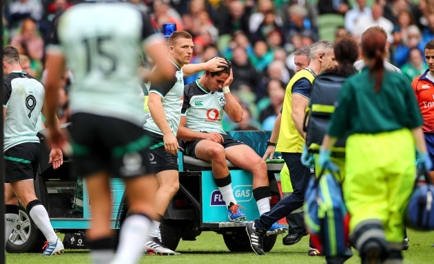 Andrew Conway consoles Joey Carbery as he leaves the field with an injury