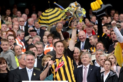 Michael Fennelly raises the Liam McCarthy Cup