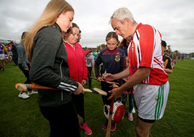 Ruby Walsh signs autographs for fans after the game