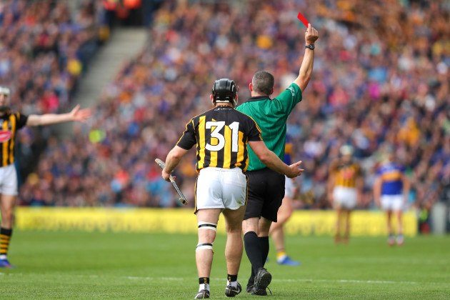 Richie Hogan receives a red card from James Owens